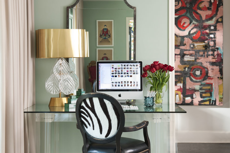 The brass shade of this new Venetian glass lamp helps tie in the gilt antiques that Shelly and Barry inherited. Mixing metals (chrome, brass, gold) energizes a room, says Shelly. A computer in a formal living room instantly turns it into a gathering place, says Shelly, who glammed things up with a Lucite desk and sexy zebra-print French chair.