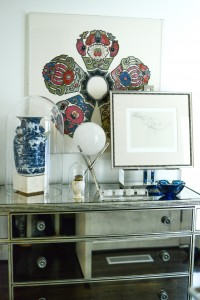 In the entry, a framed Balinese ceremonial collar; Chinoiserie vase; vintage Argentine nude pencil drawing