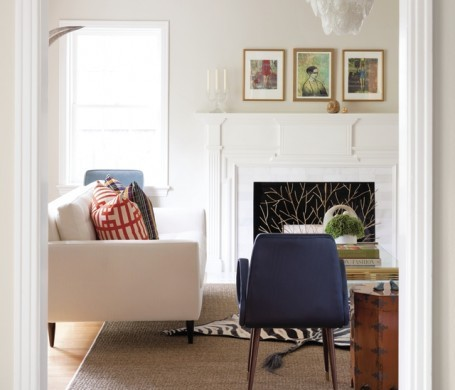 A French, art deco chair (circa 1950s) is a highlight in this Highland Park living room.