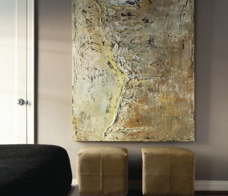 Additional seating for entertaining guests anchors a textural piece by Dallas artist Greg Barker.