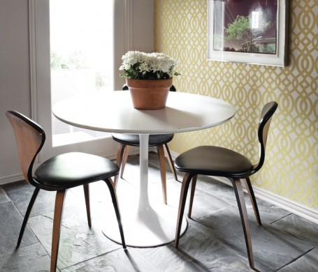 In a breakfast room, Osbourne & Little wallpaper grounds James Malone's photography, and the vintage chairs are Norman Cherner for Plycraft.