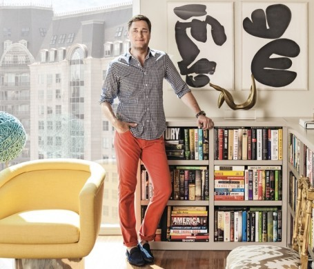 The designer, among vintage treasures, in his Uptown high-rise apartment.